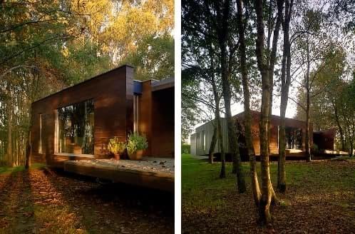Moderna vivienda de madera en el bosque crecente y rosales for Casa minimalista bosque