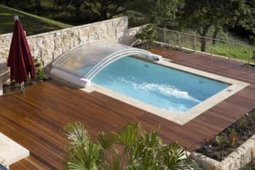 Cubiertas para piscinas con policarbonato transparente for Fotos de piscinas cubiertas