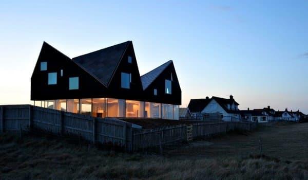 Dune-House-casa-cubiertas-inclinada-vidrio-planta-baja