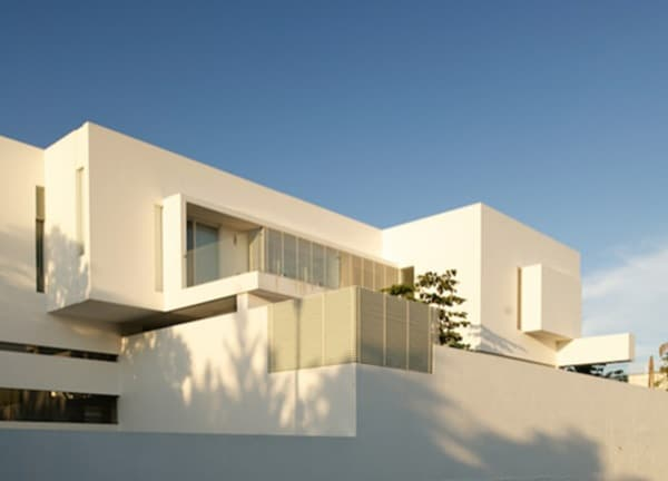 Casa lh vivienda de m ltiples salas arquigeek for Casa moderna hampton hickory