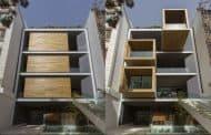 Casa Sharifi-ha: con habitaciones giratorias en fachada
