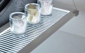 Eluma: repisas de vidrio, con marco de aluminio y LED